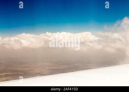 View from an airplane window at high altitude and turbines about Africa. - Stock Photo