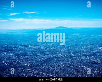 Aerial view of Kanto plain with Mount Fuji in the background - Stock Photo
