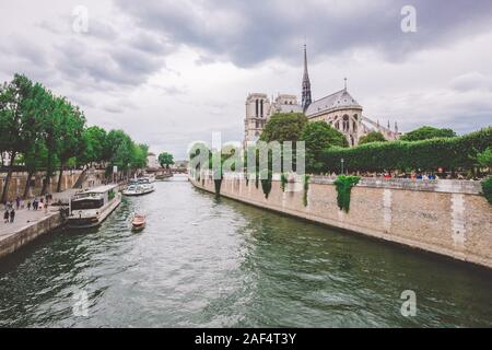 July 23, 2017. Paris, France. Notre dame cathedral from river Seine in Paris. Notre dame cathedral from river Seine Paris, France. Beautiful view of a