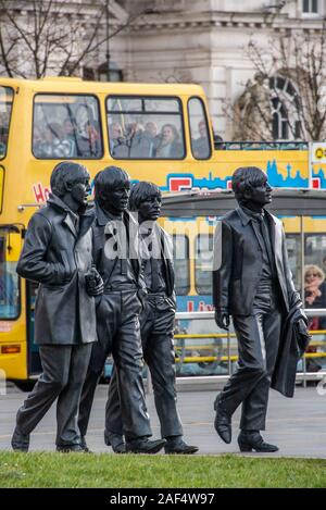 Liverpool, United Kingdom - 17 March 2019: Bronze statue of the Beatles standing on Liverpool's Pier Head waterfront, sculpted by Andrew Edwards - Stock Photo