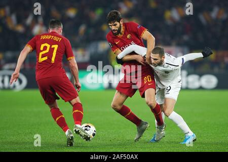 Federico Fazio of Roma (C), Jordan Veretout of Roma (L) and Shon Weissman of Wolfsberg (R) in action  during the UEFA Europa League, Group J football match between AS Roma and Wolfsberg AC on December 12, 2019 at Stadio Olimpico in Rome, Italy - Photo Federico Proietti/ESPA-Images - Stock Photo