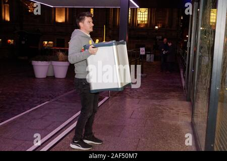 London, UK. 12th Dec, 2019. General Election 2019. Ballot boxes from Vincent Square B and Methodist Central Hall arrive for counting at QE II Centre for Cities of London & Westminster and Westminster North constituencies. Credit: Peter Hogan/Alamy Live News - Stock Photo