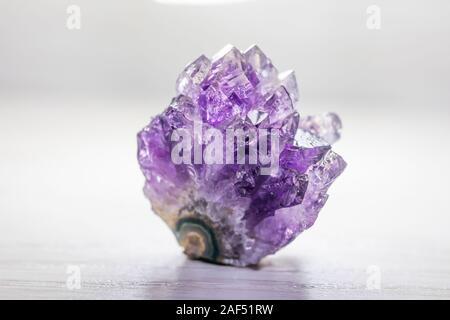 Amethyst semi precious stone in the white box - Stock Photo