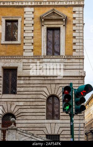 ROME, ITALY - NOVEMBER 25, 2017: Traffic lights in front of the The Piccola Farnesina, seat of Museo Barracco di Scultura Antica or Barracco Museum of - Stock Photo