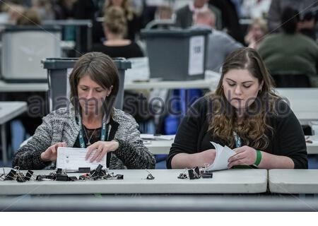 London, UK. 12th Dec 2019. UK Election: Ballot papers are counted at Brunel University London, Uxbridge - the constituency vote counting centre covering Uxbridge and south Ruislip; Ruislip, Northwood and Pinner; Hayes and Harlington. Credit: Guy Corbishley/Alamy Live News - Stock Photo