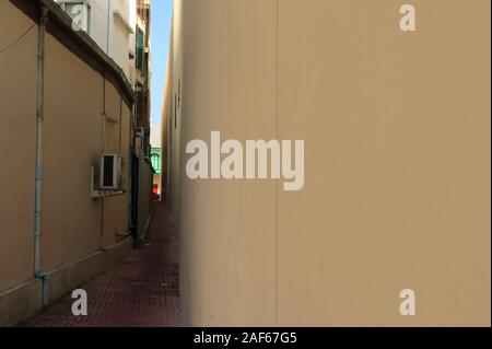 Silent narrow alley with paving stone between backs of buildings in Bangkok , down the lane concept - Stock Photo