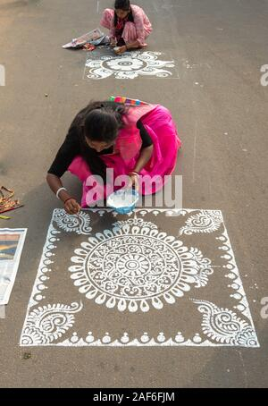 Durgapur, West Bengal / India - December 08,2019.  An Unidentified Indian Woman Participate on a Street Alpona/ Art Competition. - Stock Photo
