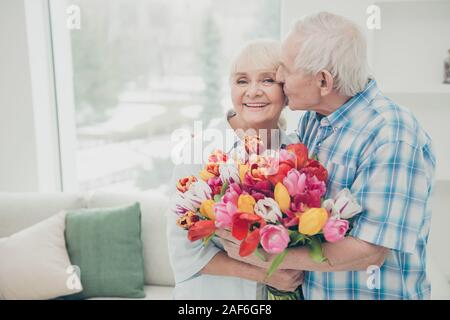 Portrait of her she his he two nice lovely cheerful cheery sweet tender people granny receiving big fresh floral tulips congrats greetings spring - Stock Photo