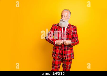 Portrait of his he nice attractive well-dressed serious imposing gray-haired man wearing checkered jacket fastening button isolated over bright vivid - Stock Photo