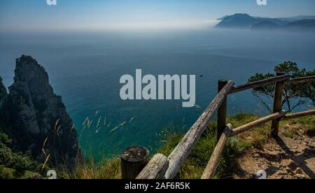 Top view of track on top the cliff near ocean - Stock Photo