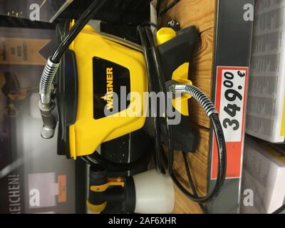 Offenbourg, Germany - Nov 11, 2019: Modern Wagner paint sprayer machine for sale inside German construction supermarket - Stock Photo