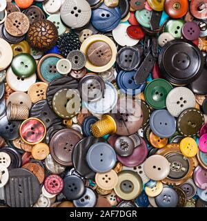 top view of heap of many various buttons close up on blue - Stock Photo