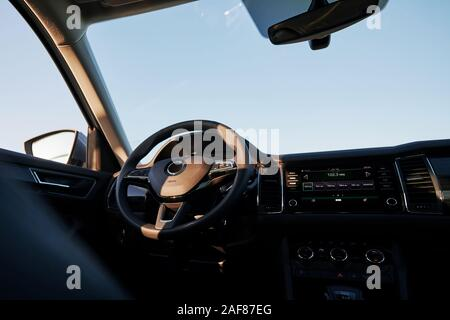 Dashboard on focus. Inside modern car. Front panel, steering wheel, quality material - Stock Photo