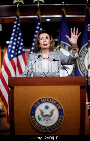 Washington DC, USA. 12th Dec, 2019. U.S. House Speaker Nancy Pelosi speaks during a press conference on Capitol Hill in Washington, DC, the United States, on Dec. 12, 2019. After a two-day marathon debate, the U.S. Democrat-led House Judiciary Committee on Friday passed both articles of impeachment, accusing President Donald Trump of abusing power and obstruction of Congress. Credit: Ting Shen/Xinhua/Alamy Live News - Stock Photo