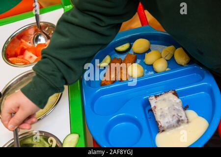 Tray of school lunch or dinner in a UK primary school - Stock Photo
