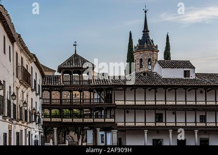 Tembleque main town square surrounded by old buildings and galleries in height in the background bell tower of Assumption Church.Toledo Spain. - Stock Photo