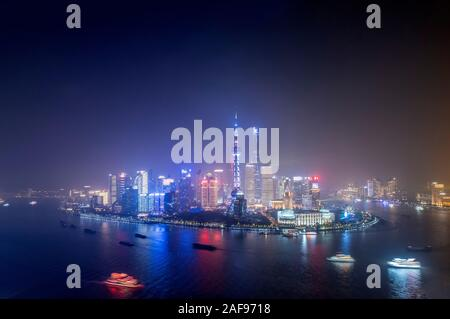 Pudong district and the skyline of Shanghai, China with the Huangpu river and tall skyscrapers - Stock Photo