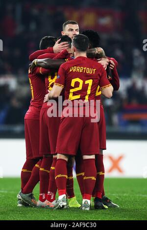 Diego Perotti of Roma celebrates with Edin Dzeko and his teammates, after scoring 1-0 goal by penalty during the UEFA Europa League, Group J football match between AS Roma and Wolfsberg AC on December 12, 2019 at Stadio Olimpico in Rome, Italy - Photo Federico Proietti/ESPA-Images - Stock Photo