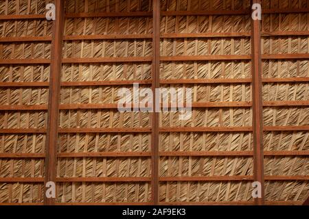 Wood and straw roof - Stock Photo