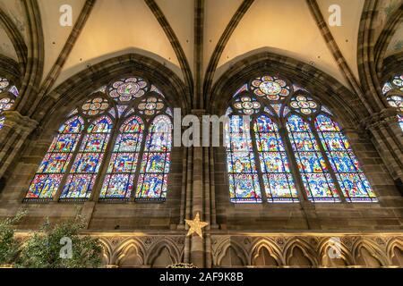 Strasbourg, France - december 1,2019: Stained glass windows inside of Strasbourg Cathedral or the Cathedral of Our Lady of Strasbourg, also known as S - Stock Photo