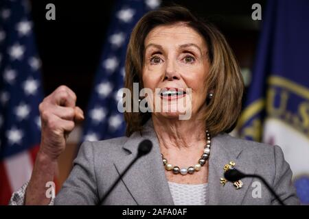 Beijing, USA. 12th Dec, 2019. U.S. House Speaker Nancy Pelosi speaks during a press conference on Capitol Hill in Washington, DC, the United States, on Dec. 12, 2019. After a two-day marathon debate, the U.S. Democrat-led House Judiciary Committee on Friday passed both articles of impeachment, accusing President Donald Trump of abusing power and obstruction of Congress. Credit: Ting Shen/Xinhua/Alamy Live News - Stock Photo