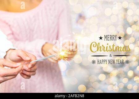 Christmas sparklers in the hands of a man and a woman. Holiday. Selective focus. People. - Stock Photo