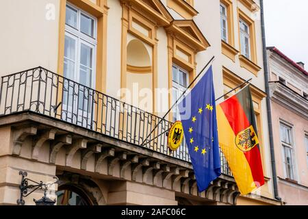 Krakow, poland - APR 30, 2019: German and European Union flags on facade of Consulate General of the Federal Republic of Germany in Krakow located in - Stock Photo