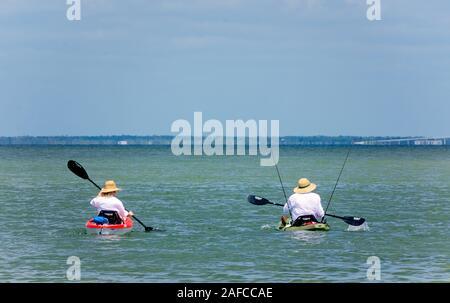 People kayak in St. Joseph Peninsula State Park, Sept. 22, 2019, in Port St. Joe, Florida. - Stock Photo
