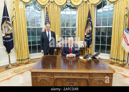 Washington, United States Of America. 10th Dec, 2019. President Donald J. Trump poses for a photo with Russian Foreign Minister Sergey Lavrov Tuesday, Dec. 10, 2019, in the Oval Office of the White House. People: President Donald J. Trump, Russian Foreign Minister Sergey Lavrov Credit: Storms Media Group/Alamy Live News - Stock Photo