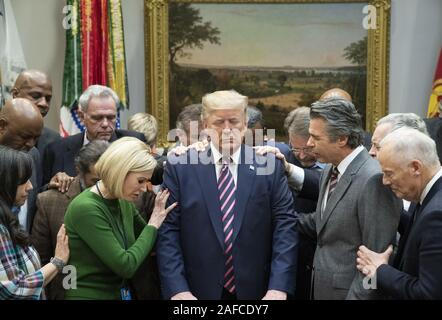 Washington, United States Of America. 12th Dec, 2019. President Donald J. Trump joins faith leaders in prayer Thursday, Dec. 12, 2019, during a meeting in the Roosevelt Room of the White House People: President Donald J. Trump Credit: Storms Media Group/Alamy Live News - Stock Photo