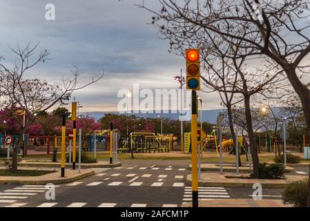 Training drive for children. Traffic educational experience - practice area for children. Mini car road, traffic signs and traffic light. - Stock Photo
