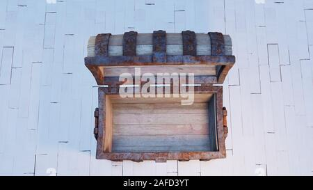Top view of an old wood with rusty metal Chest Open and empty put on a white wood floor - Stock Photo