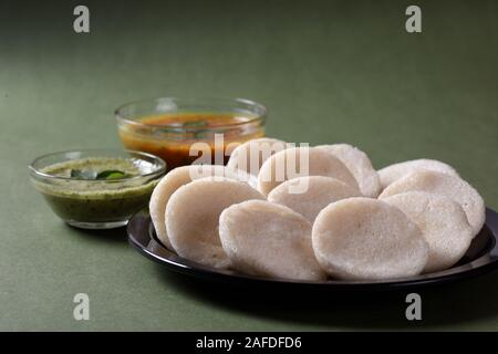 Idli with Sambar and coconut chutney, Indian Dish : south Indian favourite food rava idli or semolina idly or rava idly, served with sambar and green - Stock Photo