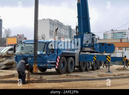 07.12.2019 Minsk, Belarus: The telescopic mobile crane Grove GMK 6300 L  at construction site. Auto crane during the unloading of cargo and building m - Stock Photo