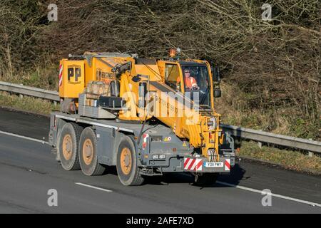 PP engineering telehandler driving on the M61 motorway near Manchester, UK - Stock Photo
