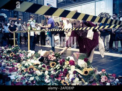 Frankfurt am Main, Germany - July 30 2019: Flowers and candles near the platform where the 8 year kid was pushed infront of an approaching ICE train. - Stock Photo