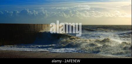 waves crashing on the marina arm - Stock Photo