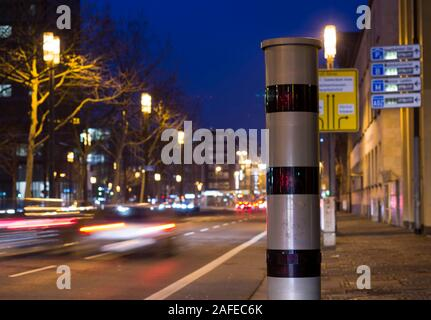 Frankfurt, Germany - March 01 2019: Vehicles passing by speed camera in city centre at night in Frankfurt am Main, Germany. - Stock Photo