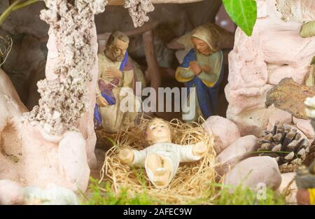 Nativity scene with provencal Christmas crib figures in terracotta - Stock Photo