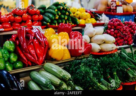 lots of vegetables on the table tomatoes cucumbers lettuce peppers