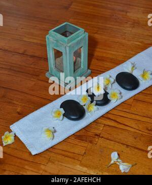 Hot spa stones set for massage treatment at luxury resort. - Stock Photo