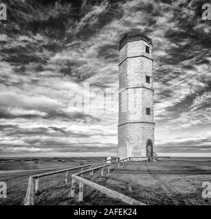 The old Chalk Tower listed building at Flamborough Head with a stunning sky backdrop, East Riding of Yorkshire, UK
