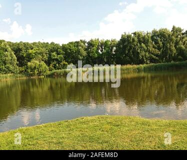 Landscape with a beautiful lake in the summer - Stock Photo