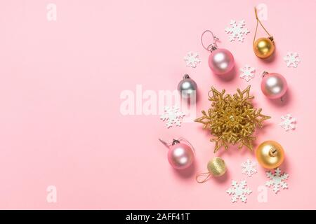 Christmas flat lay background on pink with decorations. - Stock Photo
