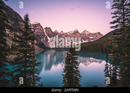An image looking over Moraine Lake in Banff National Park, Alberta, Canada.  Taken during sunrise on a calm lake.