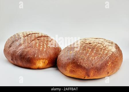 Two loaves of freshly baked bread. - Stock Photo
