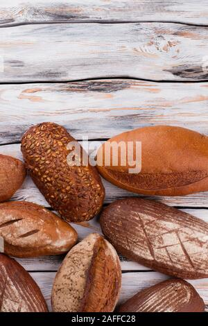 Freshly baked bread loaves, top view. - Stock Photo