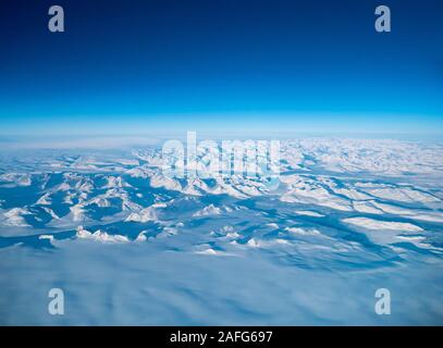 Greenland frozen landscape aerial view shot from plane. Complex Snow Mountains Stunning valley and glacier - Stock Photo