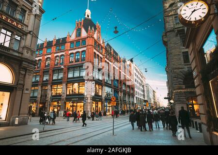 Helsinki, Finland - December 10, 2016: People Walking On Aleksanterinkatu Street In Winter Day. Street Decorated For Christmas And New Year Holidays - Stock Photo