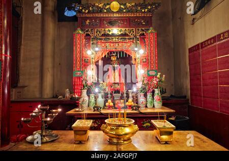 Incense urns in front of altar in Man Mo Temple dedicated to the civil god Man Tai and the martial god Mo Tai. Sheung Wan, Hong Kong, China. - Stock Photo